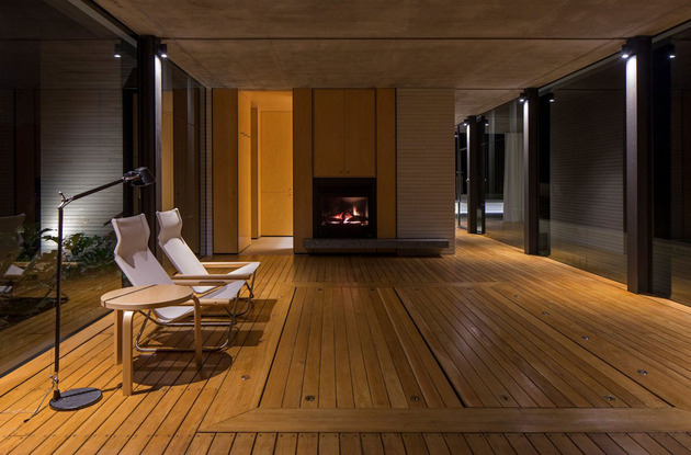 romantic-guest-house-cantilevers-spa-over-lilly-pond-15-fireplace.jpg