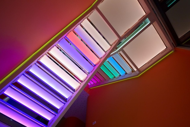 ultramodern-house-with-vibrant-lighting-design-focus-16-stairs-rainbow-up.jpg