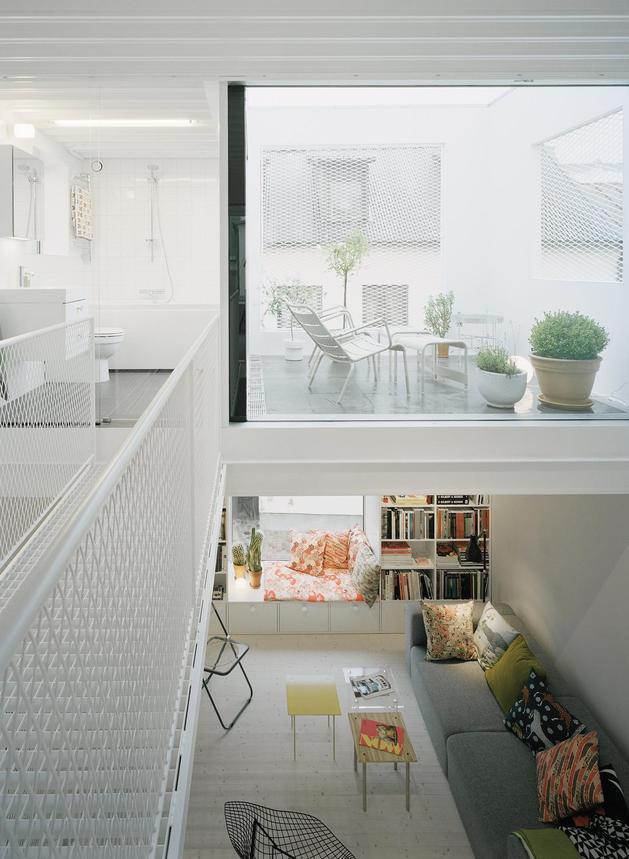 white-townhouse-with-open-interiors-detached-office-11-bridge-deck.jpg