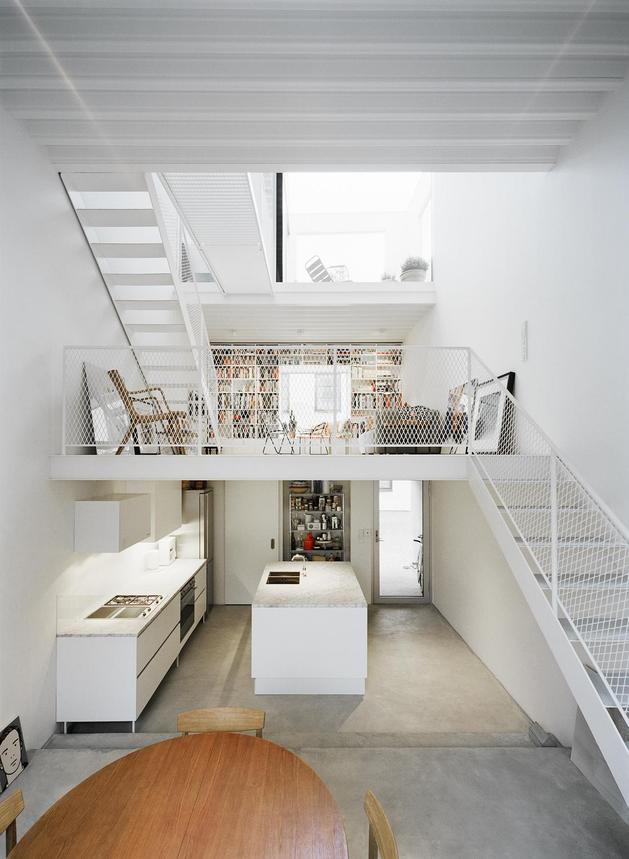 white-townhouse-with-open-interiors-detached-office-6-open-interior.jpg