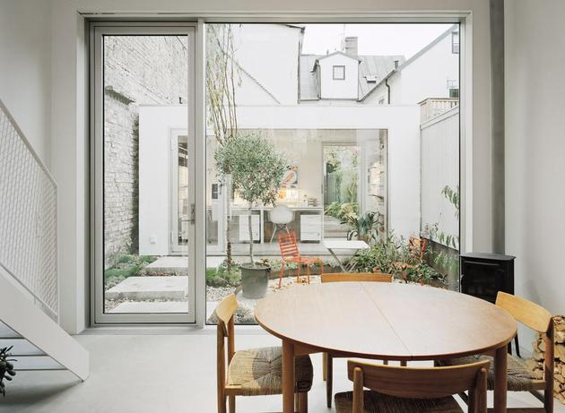 white-townhouse-with-open-interiors-detached-office-7-yard.jpg