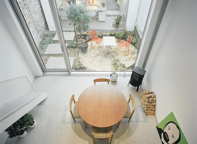 white-townhouse-with-open-interiors-detached-office-8-kitchen-table.jpg