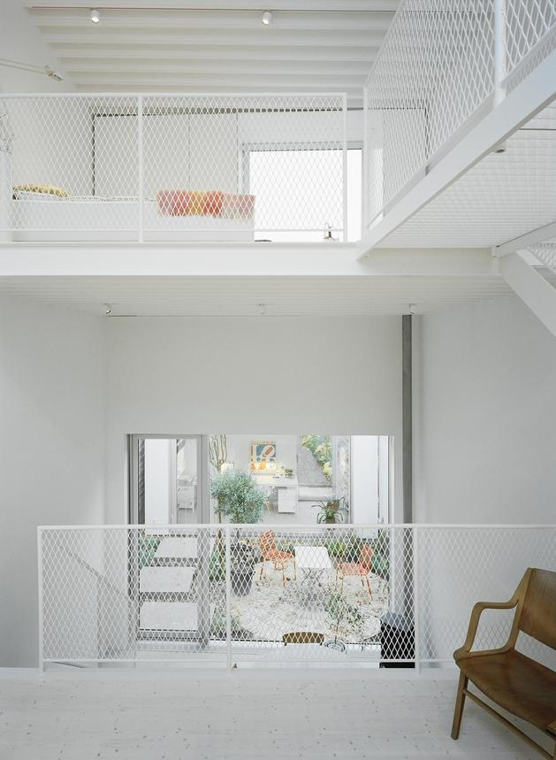 white-townhouse-with-open-interiors-detached-office-9-mesh-railings.jpg