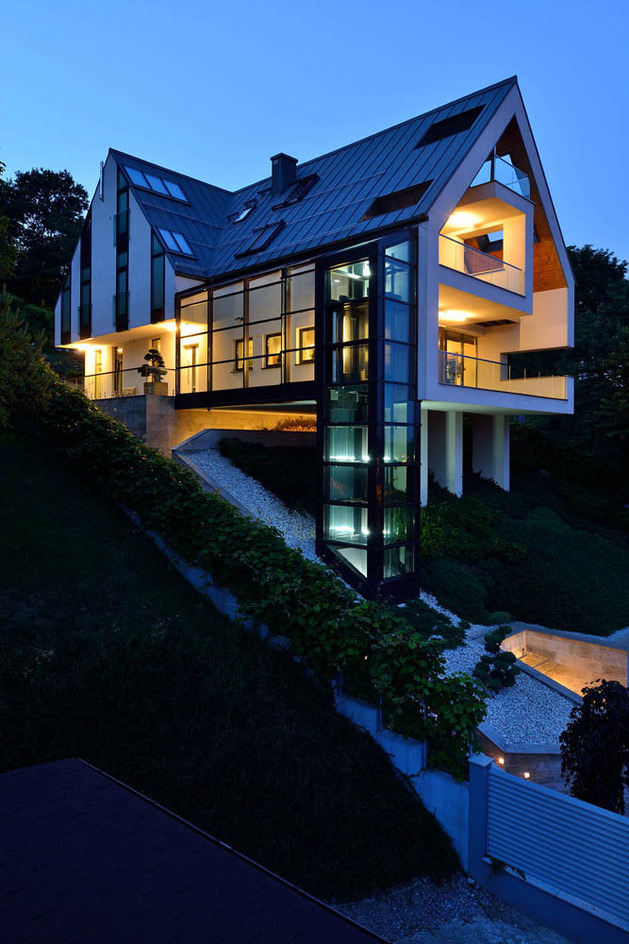 glass-elevator-multiple-levels-slope-house-26-exterior.jpg