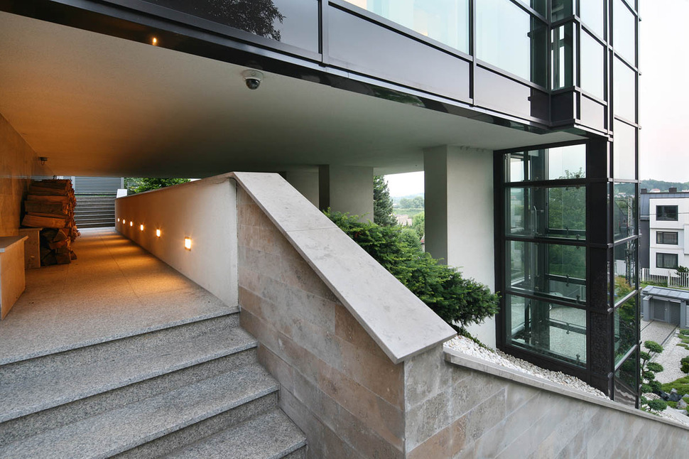 Gorgeous Glass Elevator Connects Multiple Levels On Slope