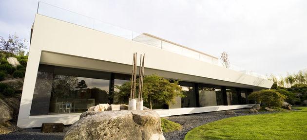 sculptural-spacious-home-2-pools-lake-10-back.jpg