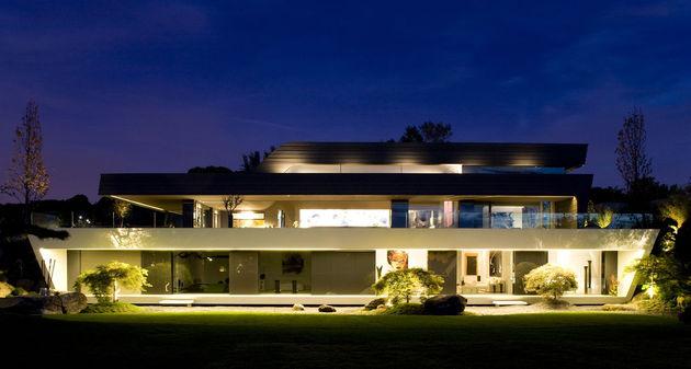 sculptural-spacious-home-2-pools-lake-11-back.jpg