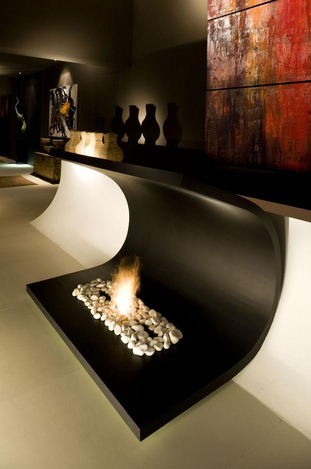 sculptural-spacious-home-2-pools-lake-18-fireplace.jpg