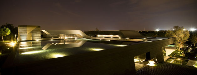 sculptural-spacious-home-2-pools-lake-6-pool-night.jpg