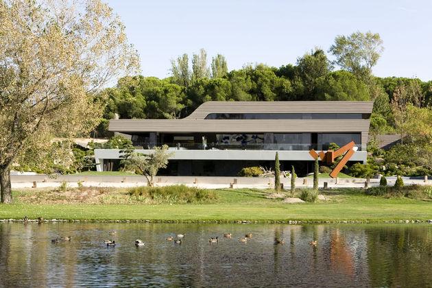 sculptural-spacious-home-2-pools-lake-9-lake.jpg
