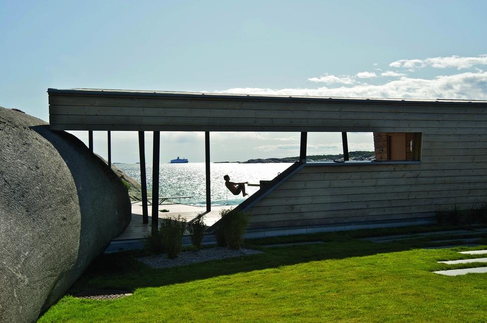 oceanfront home incorporates boulders in design