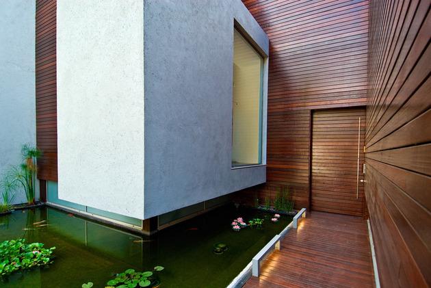 wooden-concrete-house-by-nestor-sandbank-3.jpg