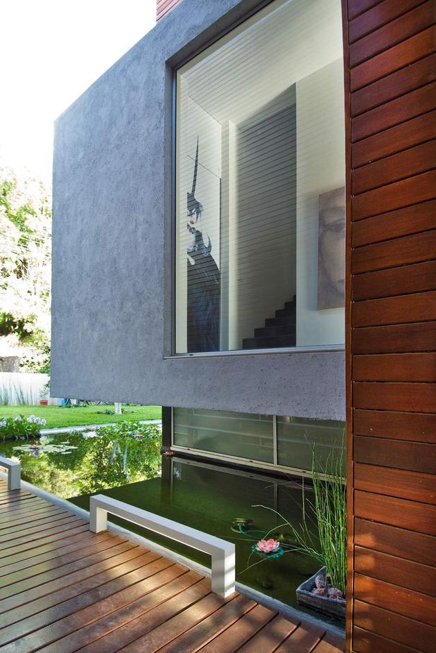 wooden-concrete-house-by-nestor-sandbank-5.jpg