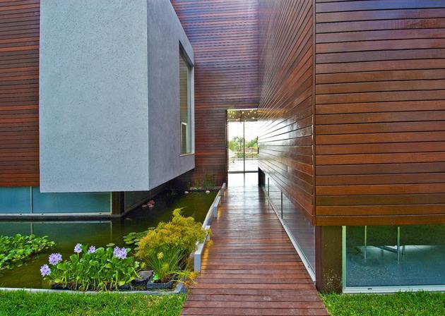 wooden-concrete-house-by-nestor-sandbank-6.jpg