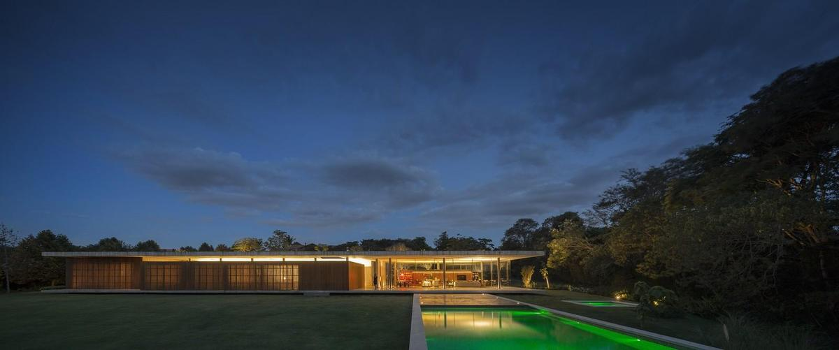 One Story House Sandwiched Between Two Concrete Slabs