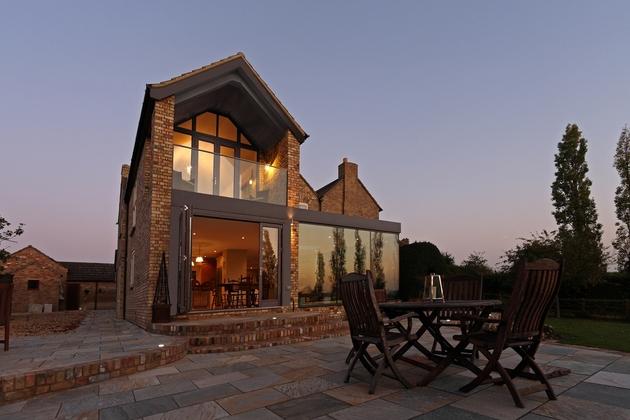modern-glass-addition-traditional-home-12.jpg