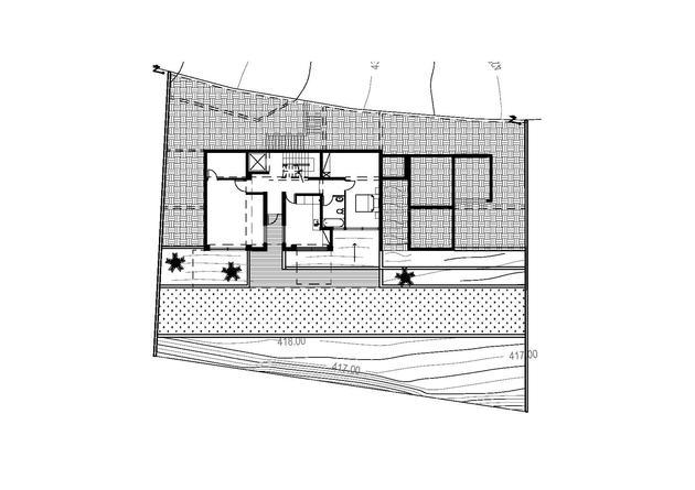 slope-home-steps-down-street-level-rooftop-garage-18.jpg