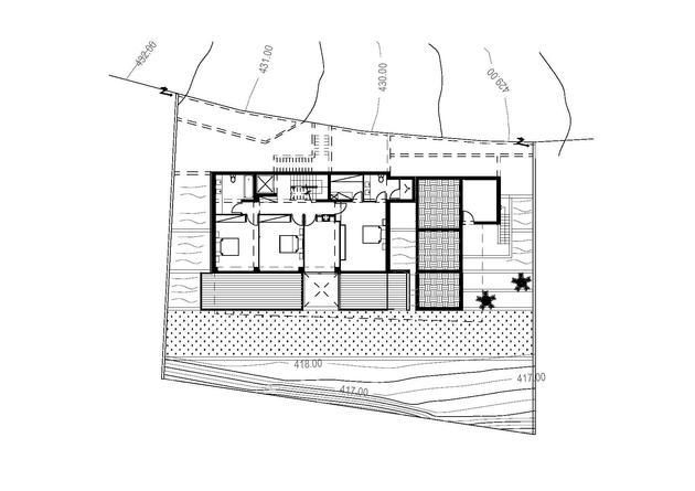 slope-home-steps-down-street-level-rooftop-garage-19.jpg