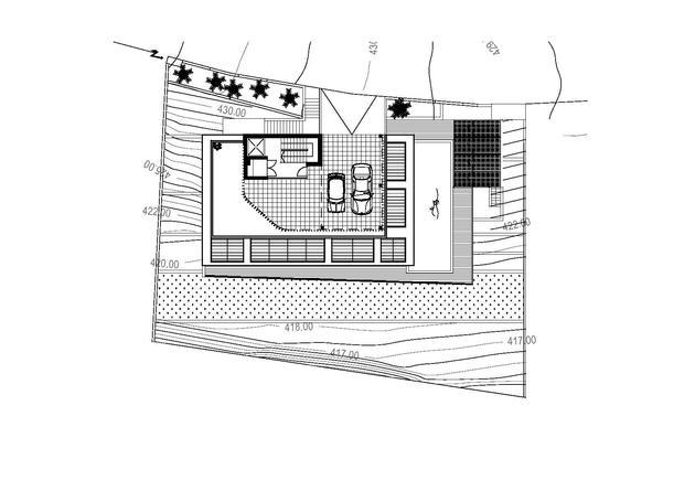 slope-home-steps-down-street-level-rooftop-garage-21.jpg