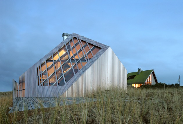 This Absolutely Awesome Turtle Roof Wood Cottage Mimics Dunes and Heats with Bio fuel