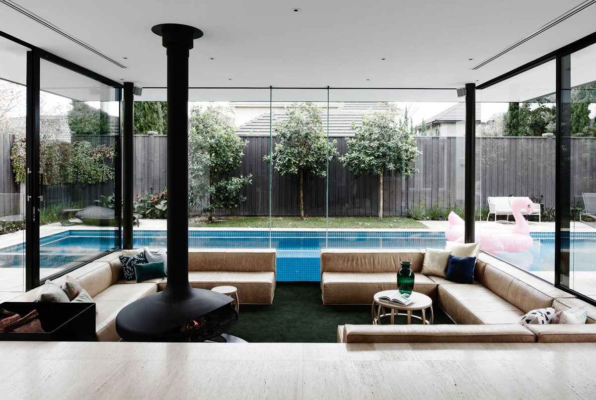 A sunken lounge room surrounded by a pool is the for Lounge designs