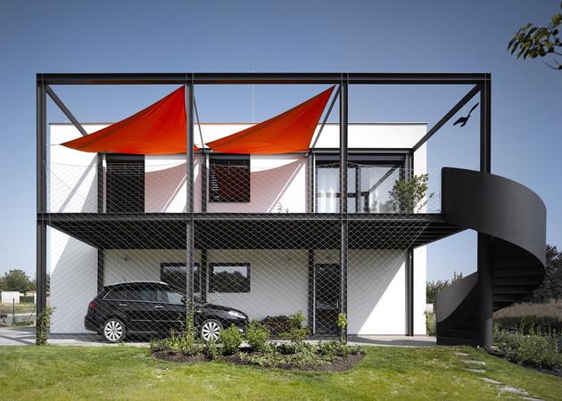 1 house racing driver features main floor car shop thumb 630xauto 58783 House for Racing Driver Features Main Floor Car Shop