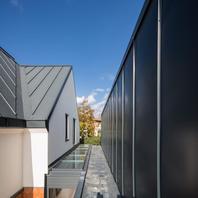 11-asymmetrical-concrete-addition-modernises-existing-home.jpg