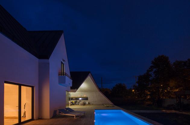 2 asymmetrical concrete addition modernises existing home thumb 630xauto 60090 Asymmetrical Concrete Architecture