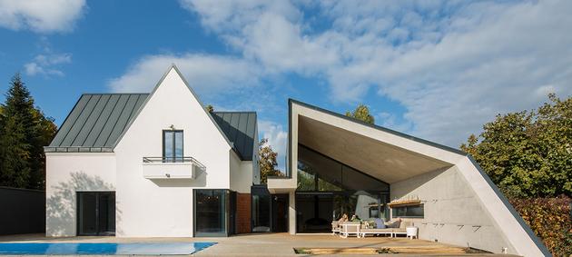 26-asymmetrical-concrete-addition-modernises-existing-home.jpg