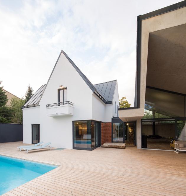 8-asymmetrical-concrete-addition-modernises-existing-home.jpg