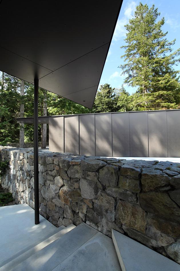 12-luxury-green-roofed-island-home-large-boulder.jpg