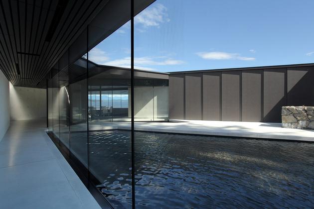 14-luxury-green-roofed-island-home-large-boulder.jpg
