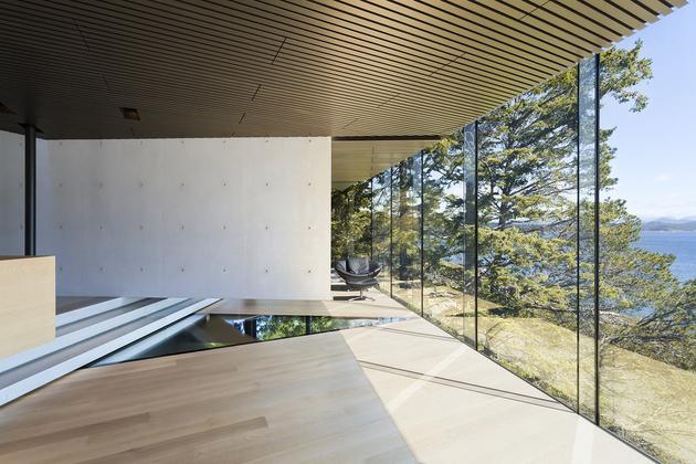 20-luxury-green-roofed-island-home-large-boulder.jpg
