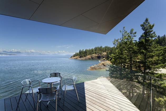 24-luxury-green-roofed-island-home-large-boulder.jpg