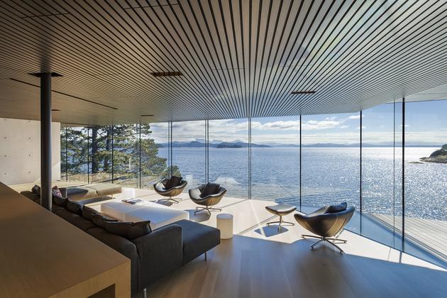 28-luxury-green-roofed-island-home-large-boulder.jpg
