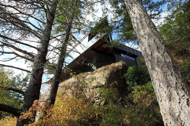 7-luxury-green-roofed-island-home-large-boulder.jpg
