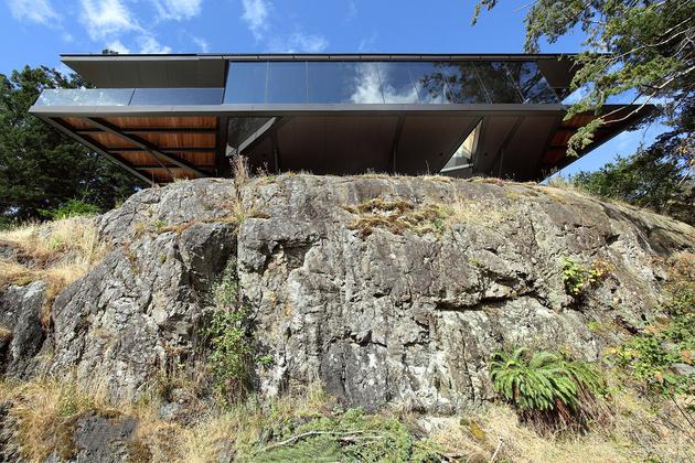 8-luxury-green-roofed-island-home-large-boulder.jpg