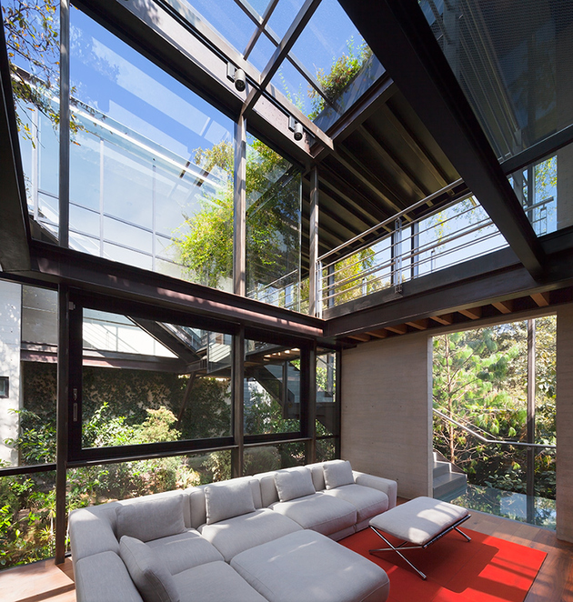 10-outdoor-elevated-glass-walkway-connects-two-sections-house.jpg