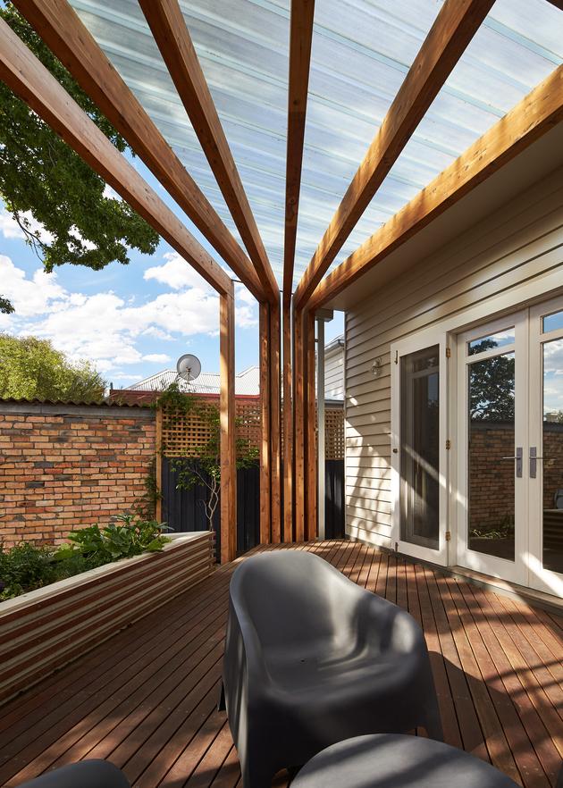 3-house-addition-triangular-deck-black-millwork.jpg