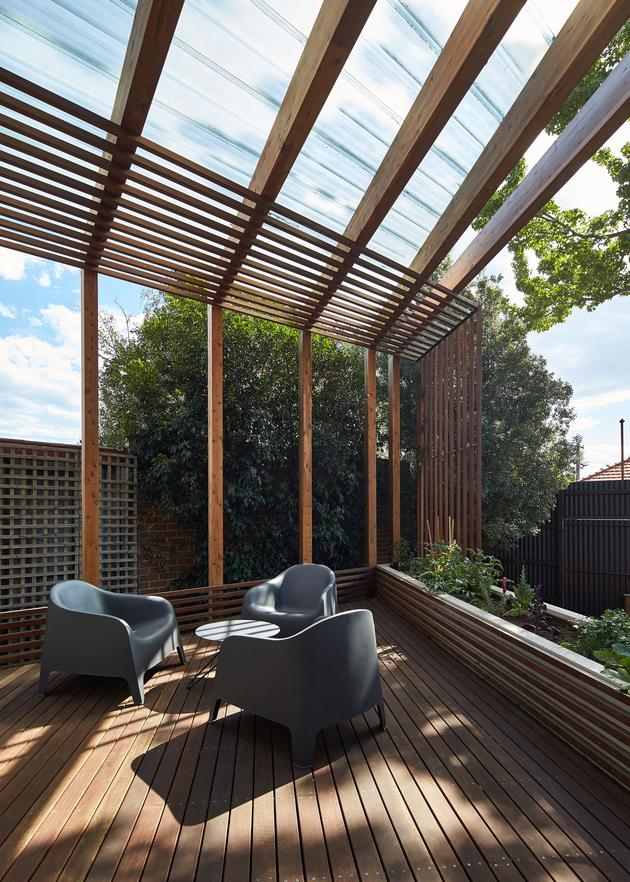 4-house-addition-triangular-deck-black-millwork.jpg