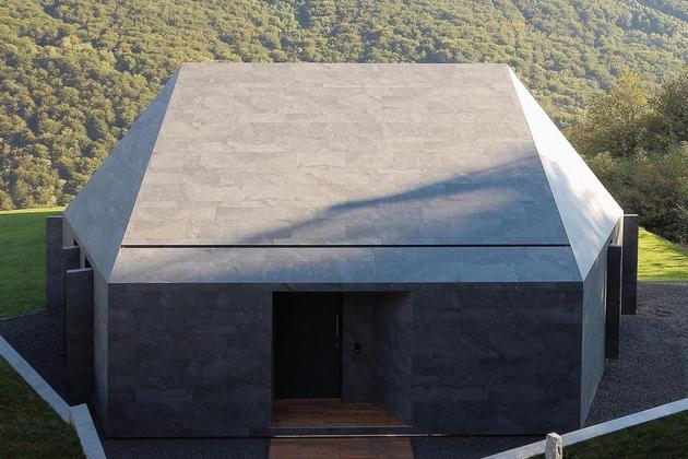 4-prefab-swiss-alps-house-designed-look-like-boulder.jpg