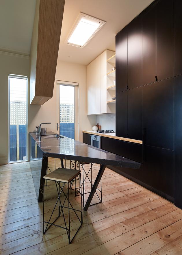 6-house-addition-triangular-deck-black-millwork.jpg