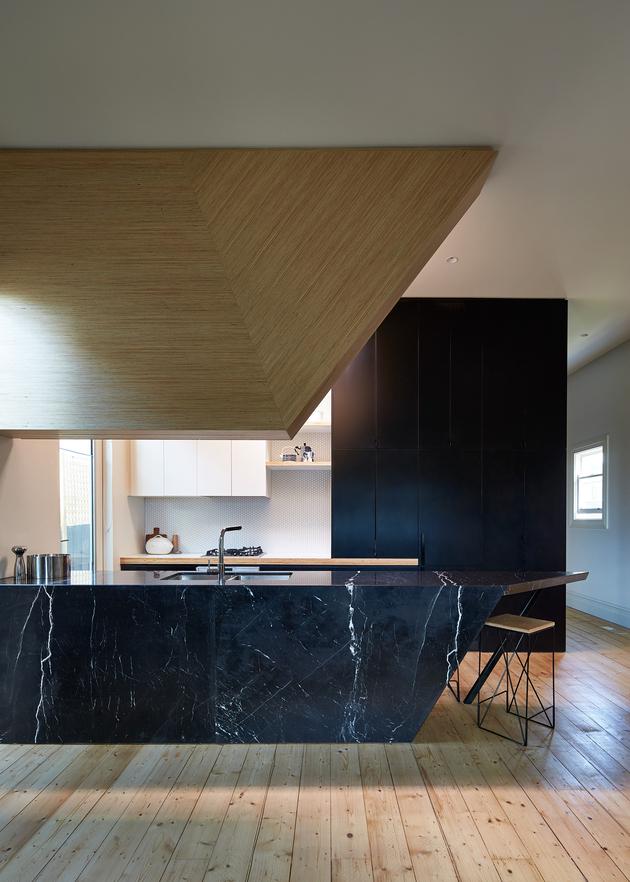 7-house-addition-triangular-deck-black-millwork.jpg