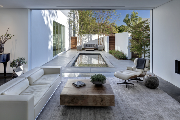 1 contemporary home opens up poolside courtyard%20 thumb 630xauto 64751 Small Courtyard Swimming Pool Home
