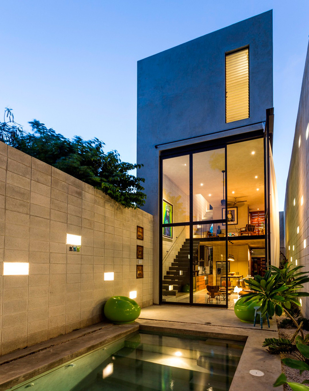 11-skinny-concrete-home-double-height-glass-doors.jpg
