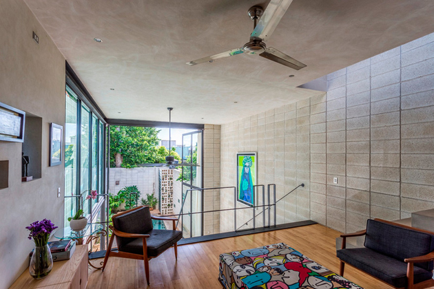 15-skinny-concrete-home-double-height-glass-doors.jpg