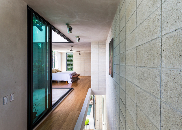 19-skinny-concrete-home-double-height-glass-doors.jpg