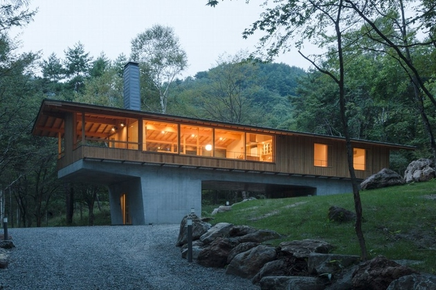 3-concrete-plinths-elevate-woodland-house-bridge.jpg