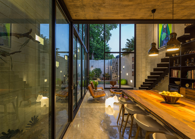 5-skinny-concrete-home-double-height-glass-doors.jpg