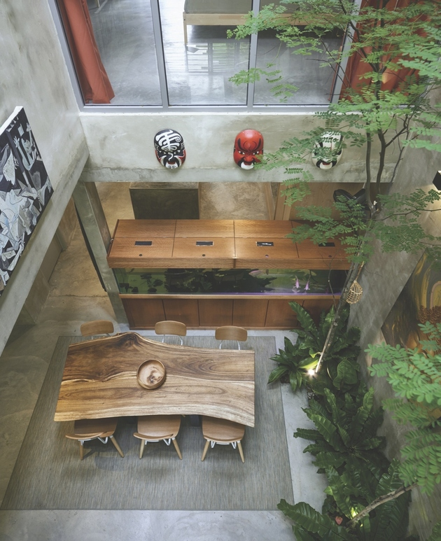 7-trees-shrubs-faux-courtyard-inside-house.jpg